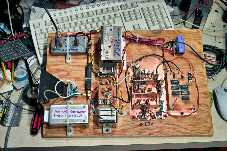 The                 sort-of-completed 10 GHz transverter, the various                 modules being screwed down to a piece of plywood.