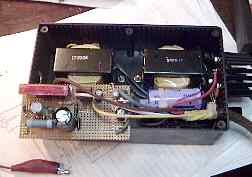 Inside view of the power supply for the                         AK-20C showing the two transforms, filter                         capacitors, and plate supply circuits.