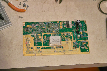 The                 circuit board showing the cut-off portion with the power                 amplifier.
