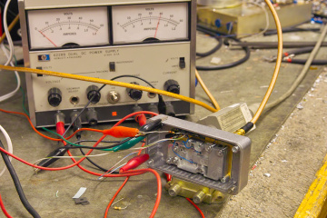 The modified VSAT power                 amplifier on the workbench